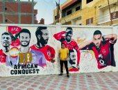 """""""إسلام"""" يهنئ النادى الأهلى ببطولة أفريقيا برسم جدارية للفريق"""