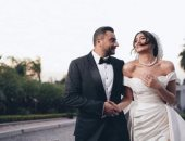 هاجر احمد تتألق بفستان من زهير مراد فى جلسة تصوير مع زوجها