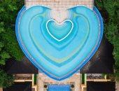 تصميم حمام سباحة على شكل قلب لجذب الزوار في جنوب الصين.. صور