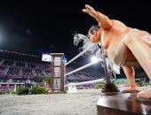 """غرائب طوكيو 2020.. تمثال مصارع السومو يرعب الأحصنة بمنافسات الفروسية """"صور"""""""