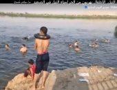 """""""مصيف النيل"""".. الأطفال يهربون من الحر لمياه النيل فى الصعيد (فيديو لايف)"""