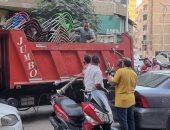 رفع 255 حالة إشغال للمحال والمقاهى بالهرم والعمرانية والطالبية