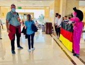 وصول أول رحلة طيران ألمانية مطار مرسى علم الدولى بعد توقف دام عاما ونصف.. صور