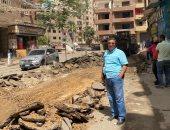 حى بولاق بالجيزة يرصف شارع ترعة عبد العال 2 ويرفع إشغالات المحال