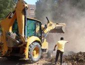 إزالة تعديات على مساحة 5 آلاف متر مربع بمدينة السباعية بأسوان.. صور