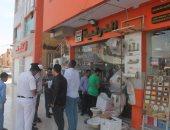 رئيس جهاز السادات: غلق وتشميع محال تجارية مخالفة بحملة جديدة