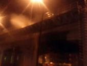 مجهولون يشعلون النيران فى إطارات السيارات أعلى كوبرى كفر الدوار بالبحيرة