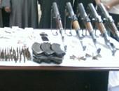 حبس 12 متهم ضبط بحوزتهم أسلحة نارية وذخيرة فى الجيزة