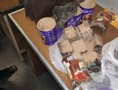 """بالصور..إحباط محاولة تهريب 2500 قرص مخدر داخل """"برطمانات"""" بمطار القاهرة"""