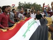 متظاهرون يحاولون اقتحام مبنى وزارة المالية العراقية والأمن يتصدى لهم