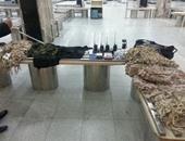 إحباط محاولة راكبة ليبية تهريب أجهزة تجسس وملابس شبيهة بزى الجيش