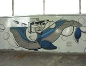 بالصور.. 35 فنانا يرسمون جرافيتى لإنقاذ حيوانات القطب الشمالى فى برشلونة