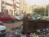 """""""واتس آب اليوم السابع"""": تراكم القمامة أمام مبنى حى حدائق القبة"""