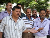 """عمال """"ساراتوجا"""" يعتصمون أمام القوى العاملة لصرف مرتباتهم"""