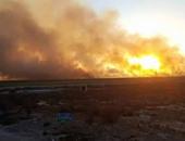 """قارئ """"اليوم السابع"""" يرسل صور حريق هائل بملاحات الطريق الدولى الساحلى"""