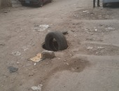"""قارئ """"اليوم السابع"""" يرسل صورا لبالوعة بدون غطاء بشارع زغلول فى الهرم"""
