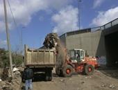 هيئة النظافة بالجيزة ترفع 250 طن مخلفات بمطالع ومنازل الطريق الدائرى