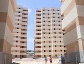 بالصور.. القوات المسلحة تسكن 11 أسرة فى مشروع غيط العنب قبل موعدهم لانهيار عقاراتهم