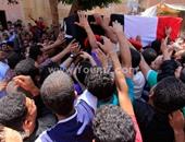 بالصور.. جنازة مهيبة لشهيد سيناء فى مسقط رأسه بالمنوفية وهتافات ضد الإخوان