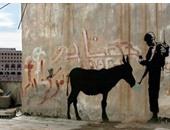 """عرض جداريتين للبريطانى """"بانكسى"""" للبيع بمليون دولار"""