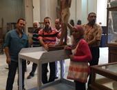 بالصور.. المتحف الكبير يتسلم 4 تماثيل خشبية تعود لعصر الدولة القديمة
