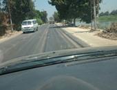 """بالصور.. تدهور طريق """"شبرا - خنيزة """" فى البحيرة رغم مرور شهر على رصفه"""