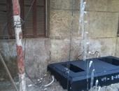 سكان عقار بالعمرانية يتضررون من تركيب كابينة تليفون تمنع فتح النوافذ