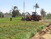 إزالة 13 حالة تعدى على أراضى زراعية وأملاك دولة بأسيوط