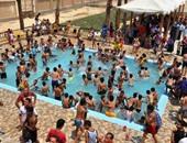 بالصور.. أطفال عرب غنيم تحتفل بافتتاح حمام السباحة فى حلوان