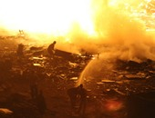 انتهاء عمليات التبريد بعد السيطرة على حريق مخازن السلاب بالأوتوستراد