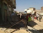 رفع 28 حالة إشغال طريق فى حملة على أسواق أسوان