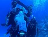 بالفيديو الصور..غطاسون يحتفلون بقناة السويس الجديدة من أعماق البحر الأحمر