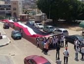 الكشافة البحرية بالسويس تنظم مسيرة بأعلام مصر احتفالا بالقناة الجديدة