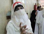 """""""المرشحة المنتقبة بعلم مصر"""": مش كل منقبة إخوانية وهدفى تغيير نظرة المجتمع"""
