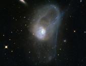 تليسكوب هابل يرصد صورة نادرة لتصادم المجرات فى حركة بطيئة