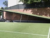 """بالصور.. أسترالى يكلف شركة معمارية ببناء جراج مشابه لما يمتلكه """"بات مان"""""""