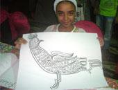 «نور» عمرها 8 سنوات تعشق الخط العربى وترسم وتزخرف آيات من القرآن و تتمنى أن تصبح طبيبة