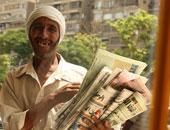 محمود حمدون يكتب : بائع الجرائد والتنين الصغير