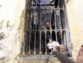 """ضبط سيدة هاربة من حكم بالمؤبد فى قضية """"حرق المجمع العلمى"""" بقصر النيل"""