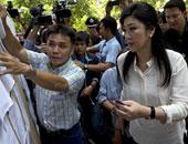 رئيسة الوزراء التايلاندية السابقة تعود من الخارج وتواجه تهم فساد