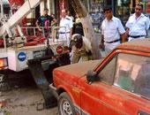 رفع 12 سيارة ودراجة بخارية متروكة فى حملات مرورية موسعة بشوارع الجيزة