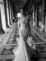 اسبقى الموضة وشاهدى أحدث فساتين زفاف لـ2015
