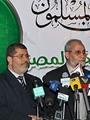 الرئيس الأسبق محمد مرسى ومحمد بديع